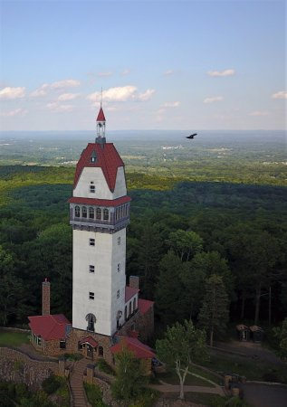 Simsbury, CT: Aerial view of Heublein Tower, Hartford is visible in the background.