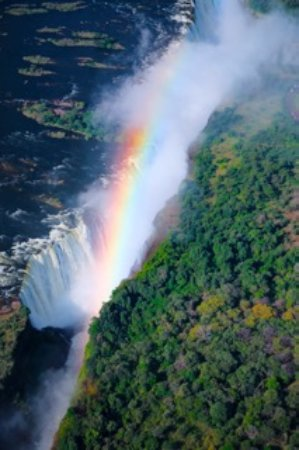 Shearwater Victoria Falls - Helicopter Flights : Rainbow and the mist that thunders