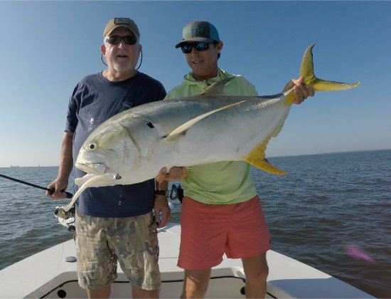 Me left and captain brian the biggest of the 5 caught for Off the hook fishing charters