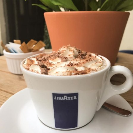 Brackley, UK: Hot Chocolate with whipped cream and crushed chocolate flakes-perfection!