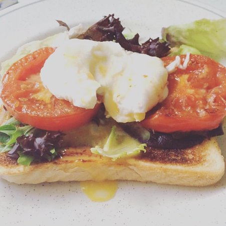 Brackley, UK: Fancy a lighter, healthier option..try our poached eggs on a bed of grilled tomato and fresh sal