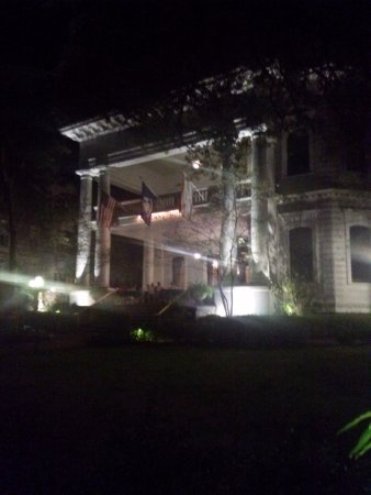 Columns Hotel Front porch at night
