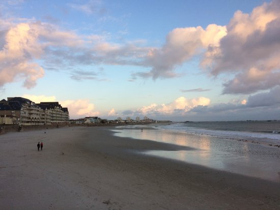 Hotel De Normandie: Sunset on the beach across the road from the hotel.