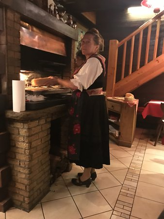 Evolene, سويسرا: The meats are gilled over a wood stove in the dining room.
