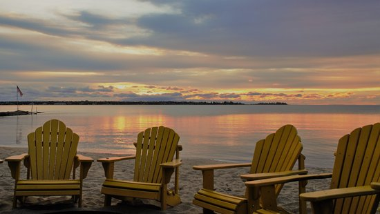 Beachfront Inn: Sunrise view from the fire pit area on the beach!