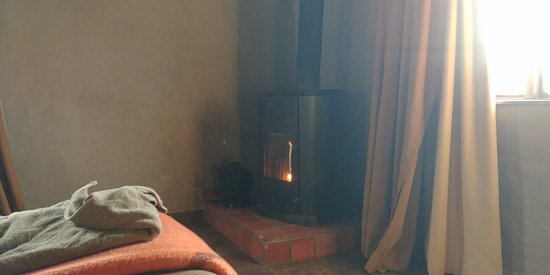 Sani Pass, Lesotho: fire made by the friendly staff at 4.30pm and kept going until you turn in.