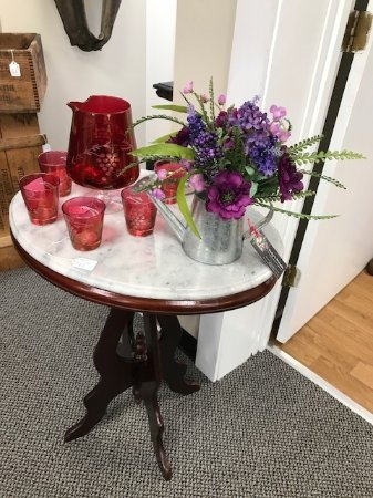Weatherd Treasures: Marble top table & red brandy snifter & matching glasses
