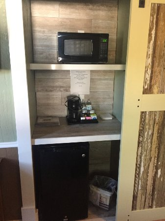 Terry, MT: shelves with microwave and coffee - sliding door to bath.