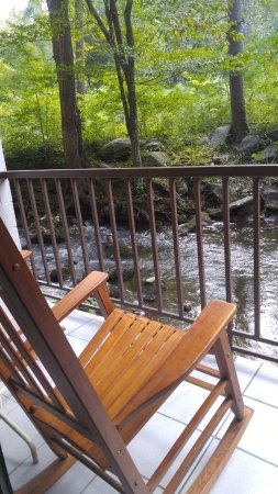 """Sidney James Mountain Lodge: Relax on the """"back porch"""" listening to the babbling brook as you rock into serenity!"""