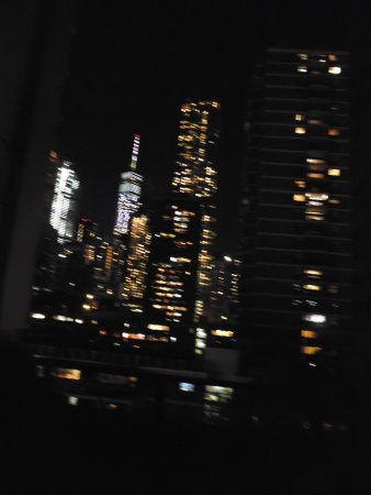 Hampton Inn Manhattan-Seaport-Financial District: View of the night lights from patio next to the room