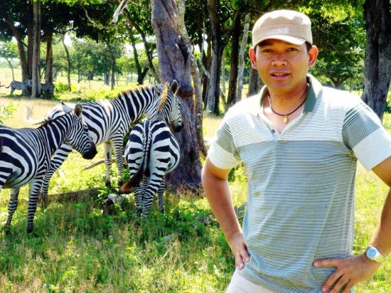 Busuanga Island, Filipinler: With some zebras in the background at the Calauit Safari Park