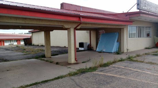 Walsenburg, CO: mattresses stacked up against building