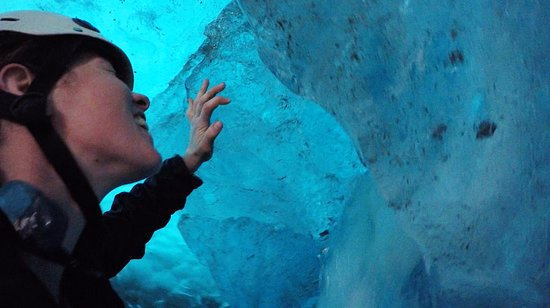 St. Elias Alpine Guides: Exploring an ice cave below the Root Glacier