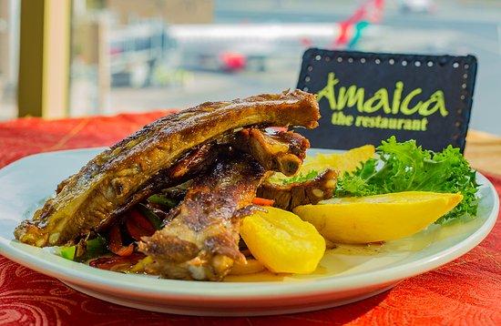 Honey Glazed Pork Ribs Served With Potato Wedges And Salad