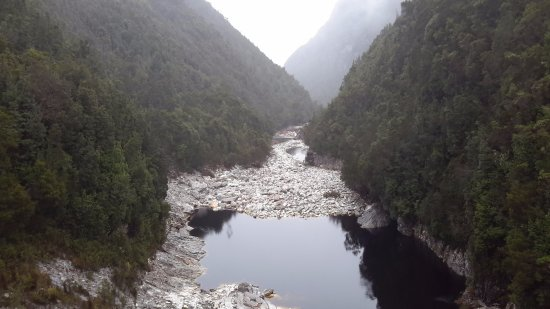 Strathgordon, Australia: Looking down the Serpentine River during a snow storm, from the dam wall