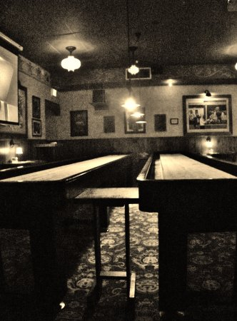 McMenamins Greenway Pub: Shuffle Board Tables In Room Where Two Pool Tables  Are Located