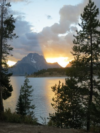 Signal Mountain Campground: The sunset is dramatically golden behind Mount Moran
