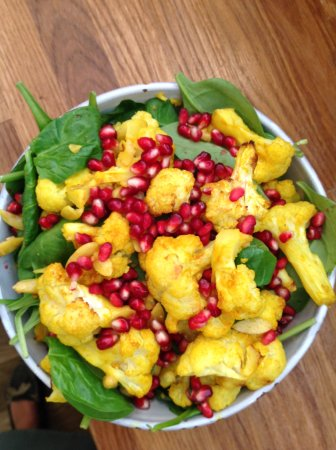 Ditchling, UK: Turmeric roasted cauliflower salad with almonds, pomegranate & fresh spinach