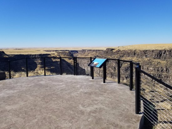 Bruneau, ID: Guardrail around one of the overlook sites. Smooth surface for handicapped.