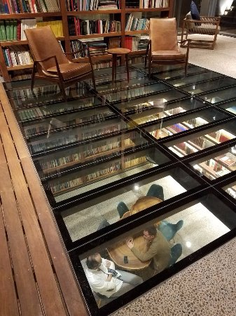 Hotel Criol 3 Story Library With Lower Level Under Glass Floor Upper At The