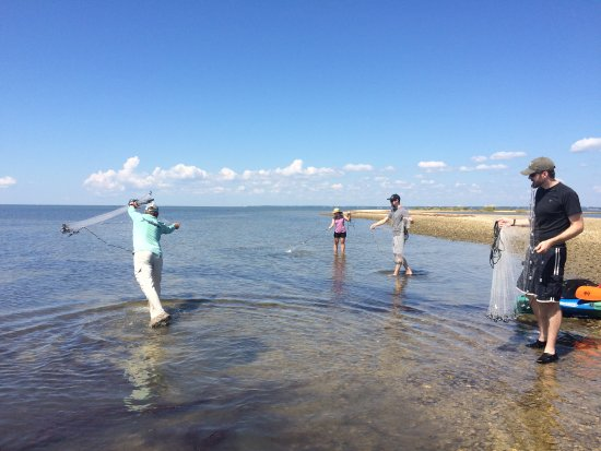 Journeys of St. George Island: Casting his net for our group of folks getting their Florida feet wet.