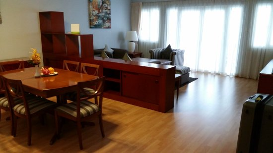Norfolk Mansion Saigon: 2 bedroom apartment - dining and lounge/tv