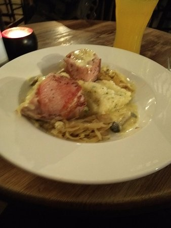 Instow, UK: Roast pheasant wrapped in bacon with garlic mash and cabbage