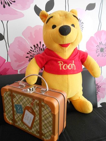 Dyserth, UK: A Very Happy Pooh Bear with his new suitcase, ready for his holibobs..... ha ha ha