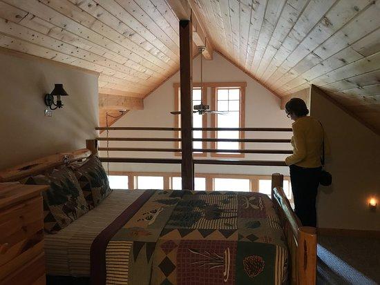 Riveru0027s Edge Resort: Upstairs Loft Looking Down On Great Room. Second  Bedroom Behind Photographer