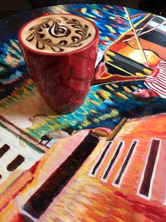 Caffespresso: Surrealistic Latte on an impressionist table!