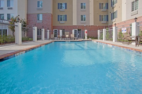 The Woodlands, TX: Relax in our sparkling pool--Texas weather lets you do so longer.