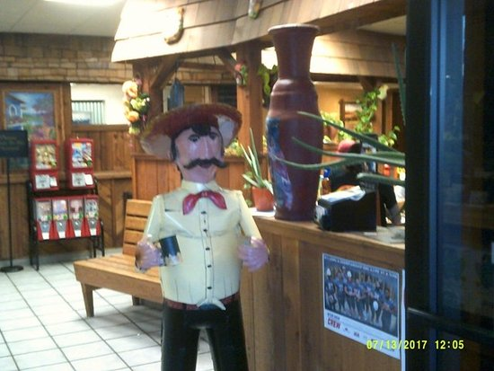Guymon, OK: this 'fello' greets you upon entering - and is holding a cup of toothpics for when you exit