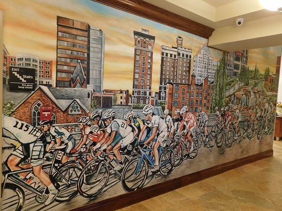 Hampton Inn & Suites Greenville - Downtown - Riverplace: cool mural in the lobby area near the business center