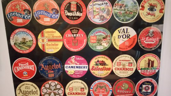Vimoutiers, Prancis: Some of the hundreds of labels of Camembert