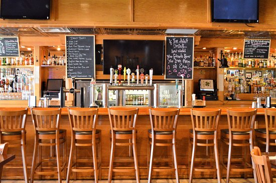 Bohemia, NY: Bar with plenty of seating and booths. Happy Hour runs from 4-7 with food and drink specials.