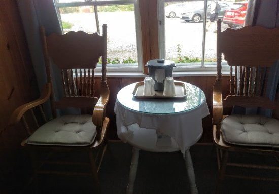 Trenton, ME: Little table and rockers near the front door