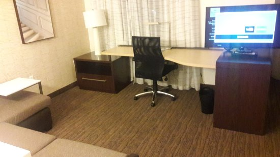 Large Desk With Electrical Outlets L Shaped Couch In View