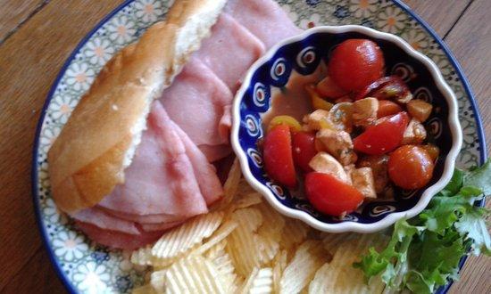 Nebraska City, NE: Muffaletta sandwich with tomato and fresh mozzarella with balsamic vinaigrette dressing