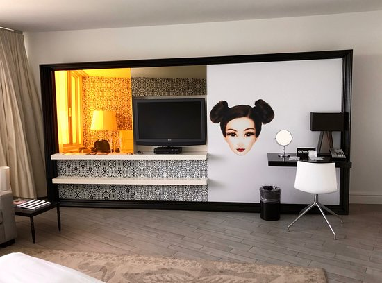 """Mondrian South Beach Hotel: The """"wall"""" lights up in different ways; a little bit of storage (that's where we hid suitcases)"""