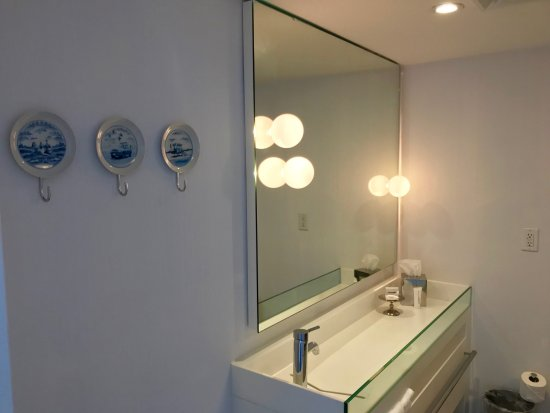 "Mondrian South Beach Hotel: Sink is the full length but doesn't fill; you can use the far end for ""stuff."" Some cubbies belo"