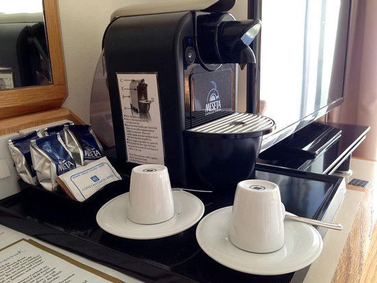 Constantinou Bros Athena Royal Beach Hotel: Coffee machine with pods in room, there is also a tray with kettle and tea, coffee