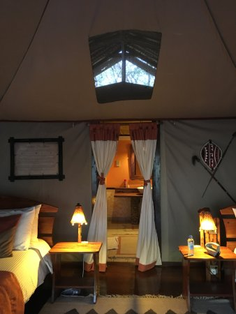 Tipilikwani Mara Camp - Masai Mara: Bedroom looking into bathroom.
