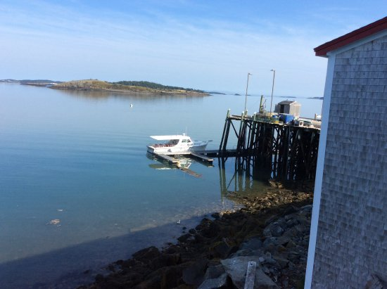 Lubec, ME: The whale watch boat and The Wharf.