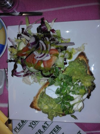 Calver, UK: Crushed avocado and poached egg, with dressed salad