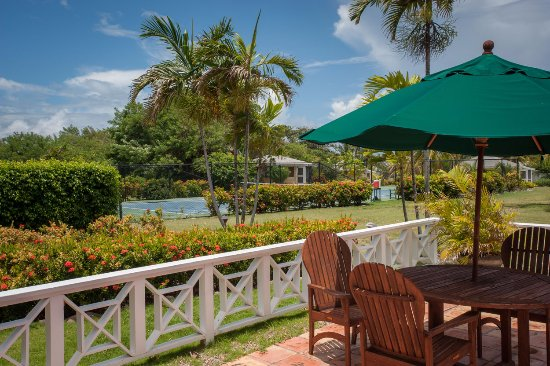 Nevis: Patio of the Great House, overlooking the Avenue of Palms and tennis court