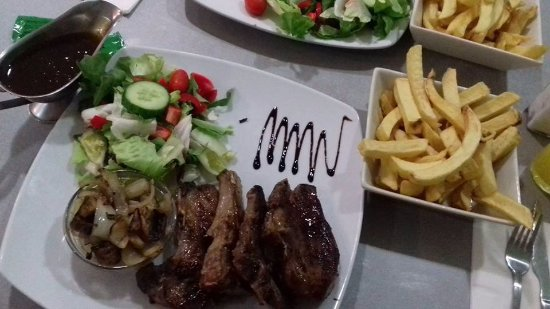 Lamb Chops served with home made chips side salad fried onions and gravy