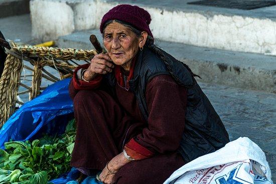 Ju-Leh Adventure: Vegetable seller in town square of Leh