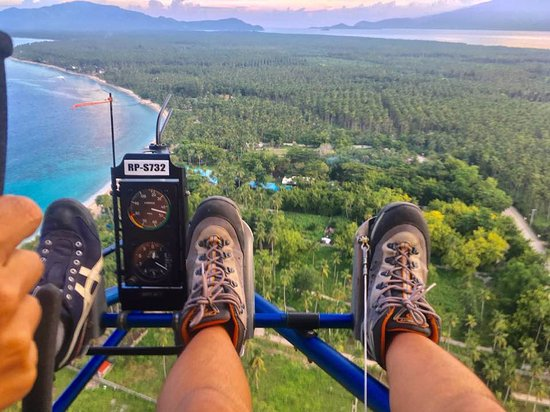 Mati, Philippines: Nothing is more exhilarating than being strapped to an ultralight and soar the skies!