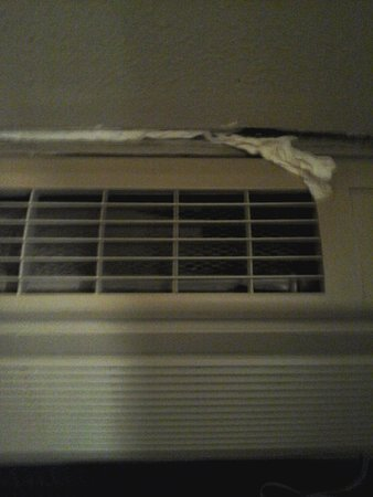 Forest Grove, OR: Toileg tissue used as around ac unit
