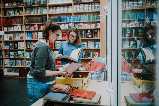 High Littleton, UK: Bookbarn Staff Sort Through Donated Books